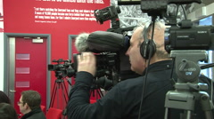 Camerman in Press Conference Stock Footage