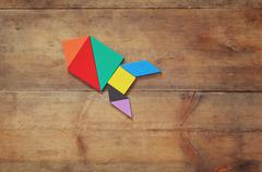 Rocket made from tangram puzzle Stock Photos