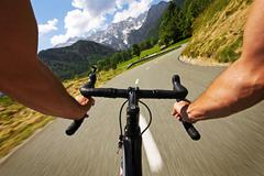 Cycling in beautiful nature close-up hands on the handlebar - stock photo