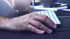 Hand using desktop computer mouse in office Stock Footage