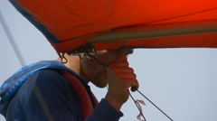 Man holds the nose of the hangglider Stock Footage