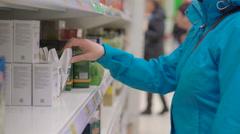 Woman choosing tea during shopping in supermarket Stock Footage