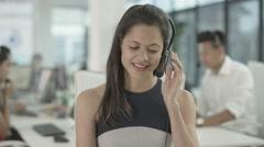 4K Friendly customer service adviser talking to a customer via video call - stock footage