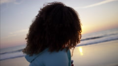 Happy Ethnic African American female on the beach listening to music Stock Footage