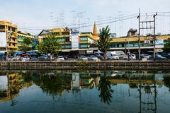 market near canal and Phra Pathom Chedi - stock photo