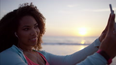 Laughing Ethnic African American female on the beach at sunset dancing for fun Stock Footage