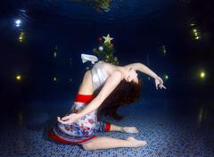 Underwater fashion in the pool Stock Photos