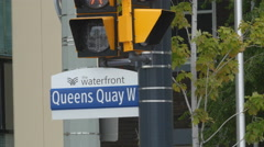 Queens Quay West street sign. Toronto, Ontario, Canada. Stock Footage