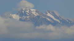 Snowy Mountain Tops in the Clouds - 29,97FPS NTSC Stock Footage