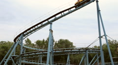 Rollercoaster train is moving along the loop - stock footage