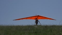 Takeoff of a hangglider in slow motion Stock Footage