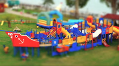 Boys and girls playing at childrens playground, Stock Footage