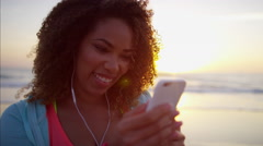 Ethnic African American female laughing using interactive smart phone technology Stock Footage
