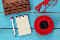 Open notebook with blank pages on wooden table Stock Photos