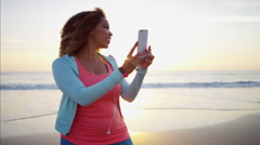 Plus size Ethnic African American female texting with smart phone  Stock Footage
