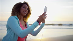 Plus size Ethnic African American female talking and waving on video using phone Stock Footage