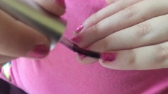 Girl painting her nails - stock footage