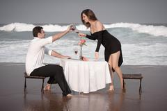 Romance Engagement Couple Love Beach Ocean Lovers Releationship - stock photo