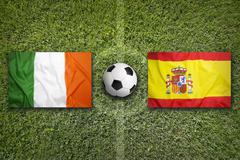 Ireland vs. Spain flags on soccer field Stock Photos