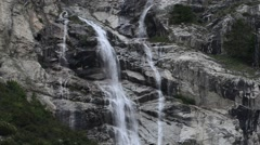 Waterfall in the Mount Blanc massif seen from the Val Veny valley, Alps Stock Footage
