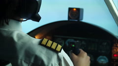 Pilot flying commercial plane, transmitting information by walkie-talkie - stock footage