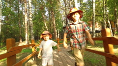 kids run together along the path from the house - stock footage