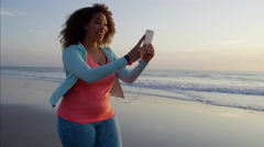 Attractive voluptuous Ethnic African American female walking at sunset outdoors Stock Footage