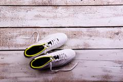 Soccer cleats against wooden background. Studio shot. Copy space Stock Photos