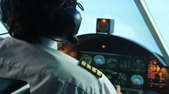 Nervous aviator trying to land the plane, talking to dispatcher on radio Stock Footage