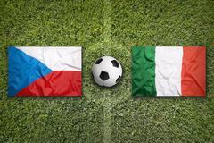 Czech Republic vs. Italy flags on soccer field - stock photo