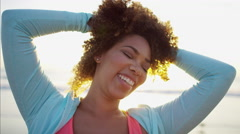 Relaxed and smiling Ethnic African American female doing gentle activity  Stock Footage