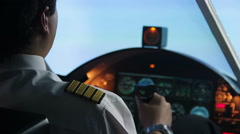 Confident pilot checking time while flying airplane, responsibility, profession - stock footage