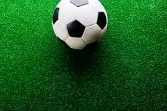 Soccer ball against artificial turf. Studio shot. Copy space Stock Photos