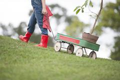 Planting park bonding child grandfather family togetherness eco Stock Photos