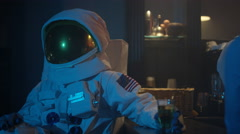 4K Astronaut relaxing in nightclub, drinking beer & blending in with the crowd Stock Footage