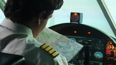 Male co-pilot checking map before operating airliner, responsibility, commitment Stock Footage