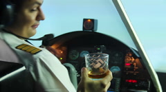 Funny pilot sitting in plane cockpit and refusing glass of whiskey, lifestyle Stock Footage