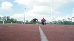 4K Disabled wheelchair athletes training together at race track Stock Footage