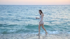 Beautiful girl on the beach alone. Travel concept. Stock Footage