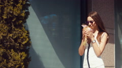 Follow shot of young attractive female walking with beautiful flower bouquet Stock Footage