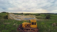 Summer nature landscape. Aerial footage. Old yellow dozer and quarry. Stock Footage