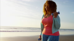Voluptuous Ethnic African American female using dumbbells for muscle workout Stock Footage