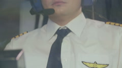 Exhausted airline captain maneuvering plane, hard work, prestigious profession Stock Footage