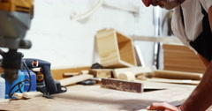 Focus on carpenter using a vise Stock Footage