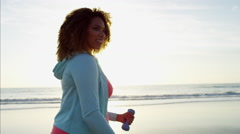 Portrait of afro hair Ethnic African American female in sportswear doing toning Stock Footage