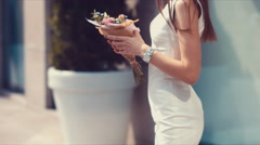 Young attractive female standing with beautiful flower bouquet Stock Footage
