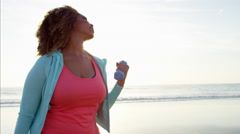 Attractive plus size Ethnic African American female at sunset doing fitness Stock Footage