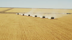 Aerial Shot Of 6 Combine Harvesters Stock Footage
