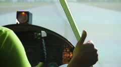 Private pilot sitting in cockpit showing thumbs up, flight simulator, cool hobby Stock Footage
