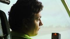 Smiling man passing flight test at airplane simulator, interesting hobby Stock Footage